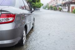 Car parking on the street of village while raining and show leve Royalty Free Stock Images