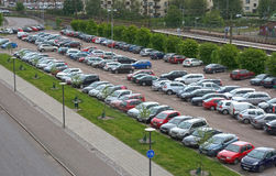 Car parking by the train station Stock Photo