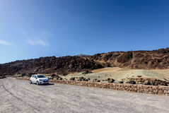Car parking among volcanic hills at Teide National par on Tenerife island, Spain Royalty Free Stock Images