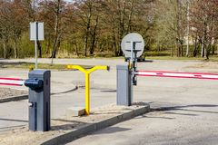 Free Car Parking With Entry And Exit Control Barriers Royalty Free Stock Photos - 143855138