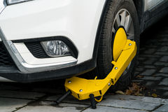 A car parks on forbidden parking lot, being wheel clamp lock. Car parks on forbidden parking lot, being wheel clamp lock Royalty Free Stock Photo