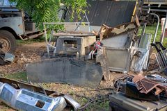 Car Parts Damaged By Flood Waters. Damaged car parts drying in the sun after being submerged in flood waters stock photos