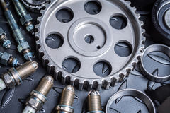 Car parts. Car motor parts, gear close-up, sparks Stock Image