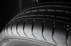 Car parts shop. Tread blocks and grooves on new tire detailed Royalty Free Stock Image