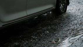 Car passes on wet asphalt after rain, slow motion stock video