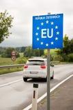 Car passing a EU (European Union) border post Stock Images
