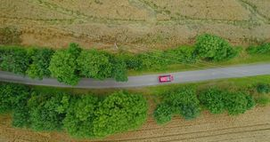 Car passing highway aerial view. Car passing highway aerial. Wide shoot of car moving route between forest. Holiday background 4K stock footage