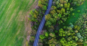 Car passing highway aerial view. Car passing highway aerial. Aerial view of car moving route between forest stock video footage