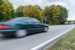 Car passing by on a national highway, Germany.  royalty free stock image