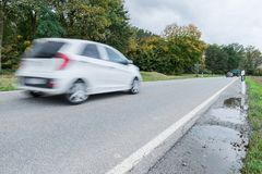 Car passing by on a national highway, Germany.  royalty free stock images