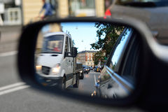 Car passing in side mirror Royalty Free Stock Image