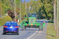 Free Car Passing Wide Farm Machinery Royalty Free Stock Images - 150602179