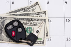 Car Payment is due. A set of car keys with cash on a calendar, Car Payment is due Royalty Free Stock Photography