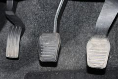 Car pedal clutch and accelerator. Clutch, brake, accelerator of car. Pedals of auto. The close up manual gear shifter car pedals Royalty Free Stock Images