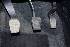 Car pedal clutch and accelerator. Clutch, brake, accelerator of car. Pedals of auto. The close up manual gear shifter car pedals Stock Photos