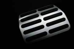Car Pedal. In the deep shadows. Selective focus Royalty Free Stock Photography