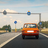 Car on a pedestrian crossing. Russian old car on a pedestrian crossing Stock Photos