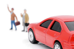 Car and people. Model car in front of which stands the figure of people Royalty Free Stock Photo