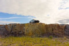 A car perched on a cliff in the northwest territories Stock Photo