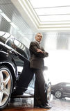 This car is perfect for me. Confident senior businessman leaning Royalty Free Stock Image