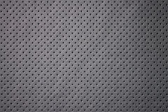 Car perforated leather background. Stock Photos