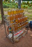 Car petrol in bottles sold at roadside in many poorer Asian countries. It is common to see small stall selling gasoline in plastic or glass bottle in many stock image