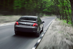 Car Peugeot 407 drive on asphalt countryside forest road at daytime Stock Photography