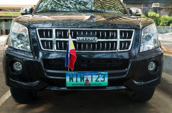 Car with philippine flag. MANILA, PHILIPPINES - JUNE 7, 2015: Isuzu car with philippine flag and license plate. 2.5 million cars in Manila cause 85% of the air stock photos