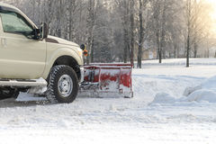 Car pickup cleaned from snow by a snowplough during wintertime Royalty Free Stock Photography