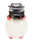 Car on piggy bank Stock Images