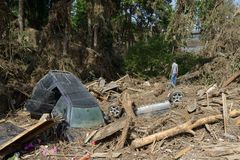 A car in a pile of debris after floods Stock Images