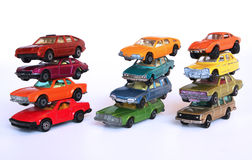 Car piles. Three piles of colorful toy cars isolated on white Royalty Free Stock Photos