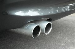 Car pipe. Sports car exhaust close up royalty free stock images