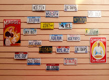 Car plate and retro posters display Royalty Free Stock Photo