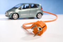 Car and plug Royalty Free Stock Image