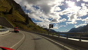 Car point of view crossing Swiss Alps in Summer stock video footage