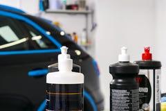 Car polish wax concept. Buffing and polishing car. Car detailing. Polish paste and tube. Polishing car service. Polish tools.  stock images