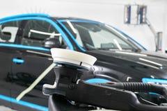 Car polish wax concept. Buffing and polishing car. Car detailing. Polish paste and tube. Polishing car service. Polish tools. Car polish wax concept. Buffing stock image