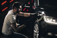 Car polish wax. worker hands holding a polisher. And polish car Stock Photos