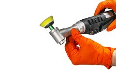 Car polish wax worker hands holing polishing tools in protective gloves isolated on white background. Buffing and polishing car co. Ncept. Man holds a polisher stock image