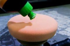 Car polish. White liquid polish on polishing pad royalty free stock photos