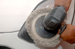 Car polished by machine, hand held polishing machine Royalty Free Stock Image