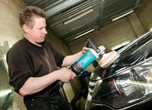 Car polishing worker Stock Photo