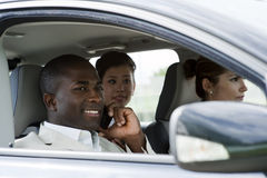 Car pooling. Multi-ethnic businesspeople sharing a car Stock Photography