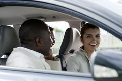 Car pooling. Multi-ethnic businesspeople sharing a car Royalty Free Stock Images
