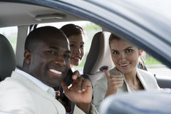 Car pooling. Multi-ethnic businesspeople sharing a car Stock Image