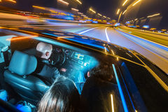 Car pooling at night Stock Photo