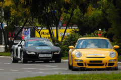 CAR PORSHE GT3 AND AUDI R8. BELGRADE-JUNE 26 : CITY OF BELGRADE 24h RACE,500km PREMIERE EDITION,CAR PORSCHE GT3 AND AUDI R8 on work out driving,JUNE 26, 2010 in Stock Photos