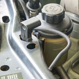 Car power steering oil reservoir royalty free stock photos