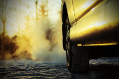 Car and powerful exhaust fumes in the air in Finland. Stock Photography